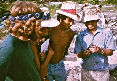 Admiring a stone adze on Huahine were (left to right) Patrick McCoy, Toni Han Palermo, Tim Lui-Kwan, and Yosi Sinoto.